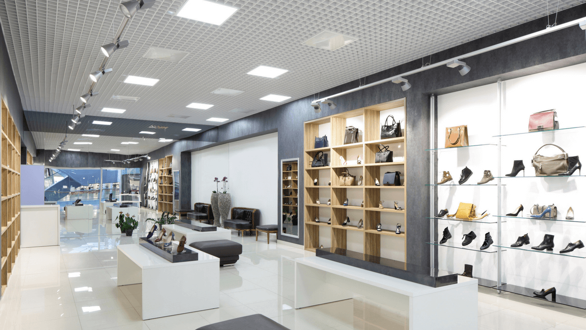 Bags and shoes on display in a store with 3 basic types of lighting