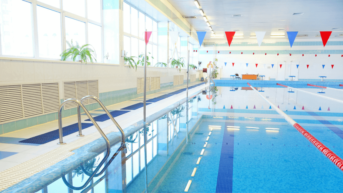 Indoor public swimming pool with bay window and lighting