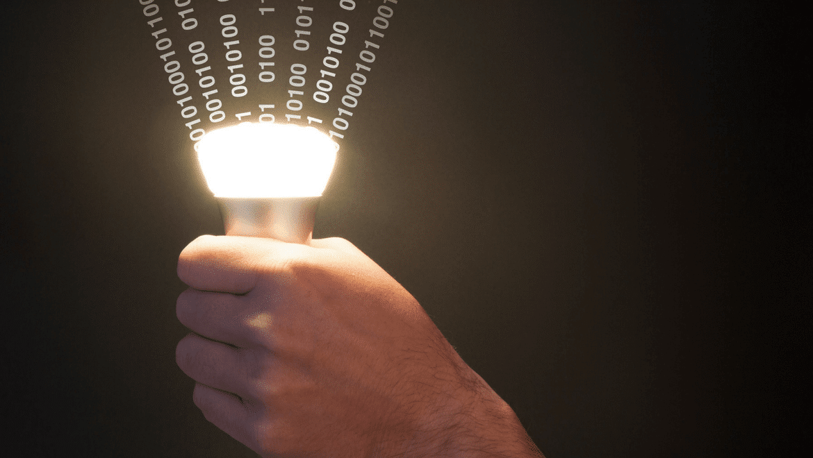 Lifi technology: Hand holding a light with numbers coming out of it