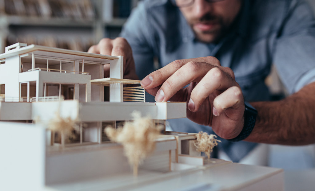 architect working on a building model and asking himself why is lighting essential to architecture