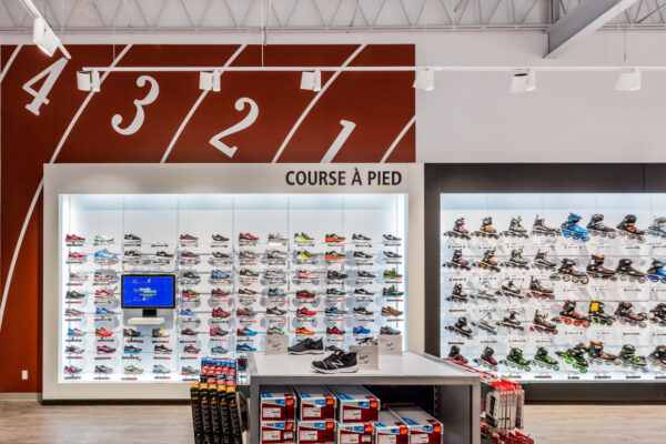retail indoor lighting of Beloeil Sport Expert store lighted with track lighting and spot light to create an incredible customer experience